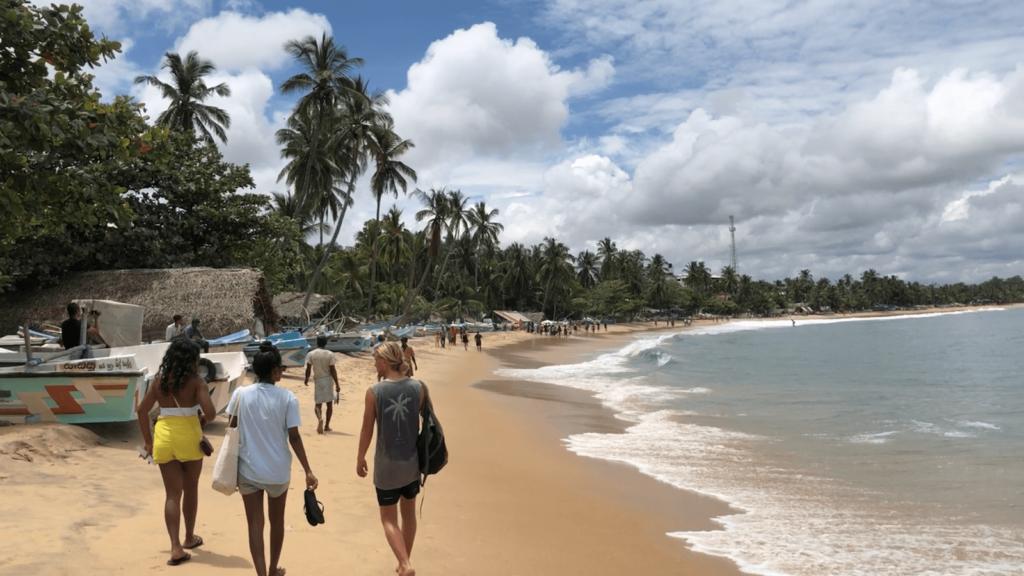 People walking at Arugam Bay beach