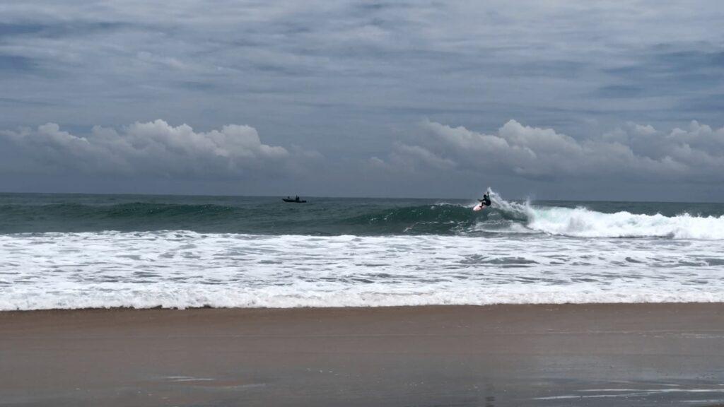 Surfer at the waters in Arugam Bay Beach Sri Lanka