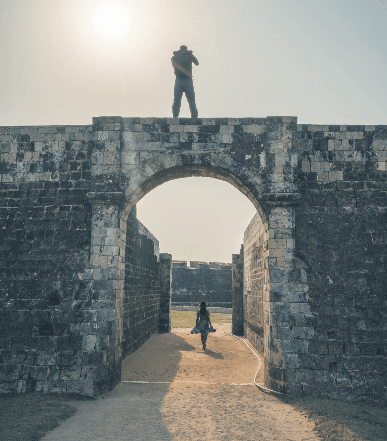 Photographer taking a picture of a woman at Jaffna Fort