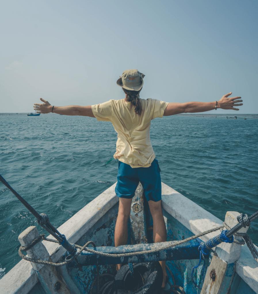 Steve Yalo imitating the Titanic pose on a boat in a lake in Sri Lanka