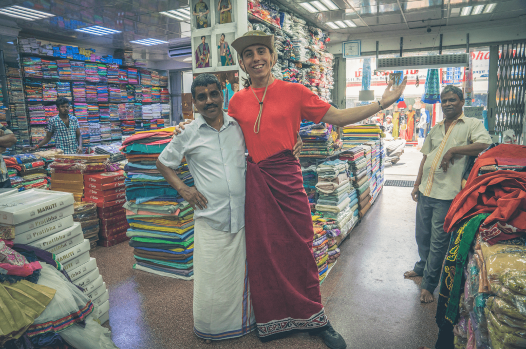 Steve Yalo posing with a local while shopping in Jaffna
