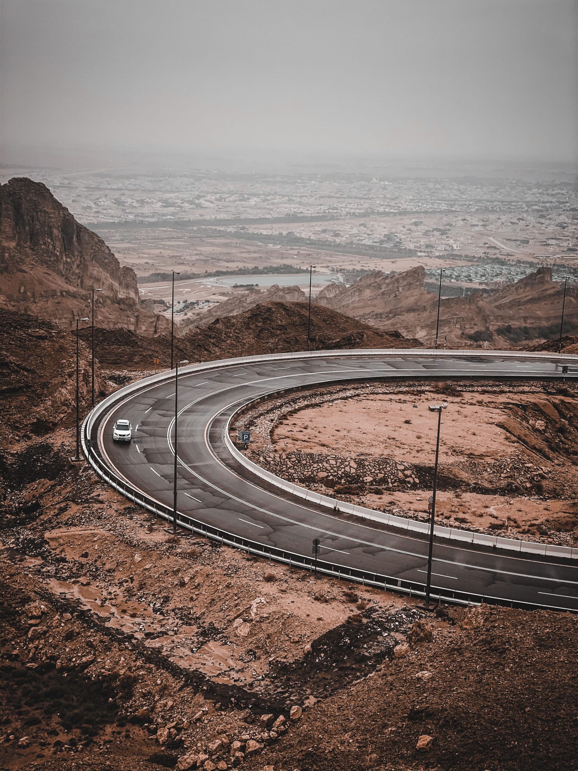 Curve Road on Jebal Hafeet Al Ain with an overview of the town in front